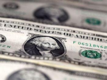 Dólar fechou em queda de quase 2% nesta quarta-feira (15), retornando ao patamar de R$ 3,11 (Foto: REUTERS/Dado Ruvic/Illustration/File Photo)