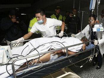 Jogador Alan Ruschel é socorrido após queda de avião na Colômbia. Foto: Divulgação